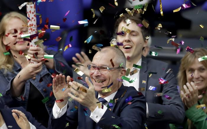 Green Party's gay rights activist Volker Beck, center, and fellow faction members celebrate with a confetti popper after German Federal Parliament, Bundestag, voted to legalize same-sex marriage.