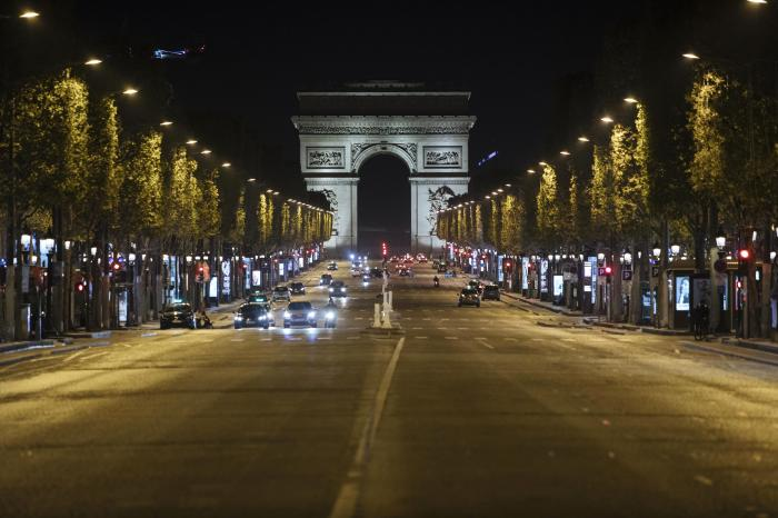 amps-Elysees avenue is almost empty during curfew in Paris, Saturday, Oct. 17, 2020.