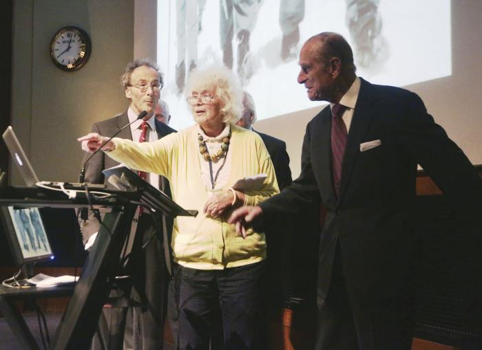 Travel writer, journalist and author, Jan Morris, center, with the Duke of Edinburgh, right, during a reception to celebrate the 60th Anniversary of the ascent of Everest, at the Royal Geographical Society in London.