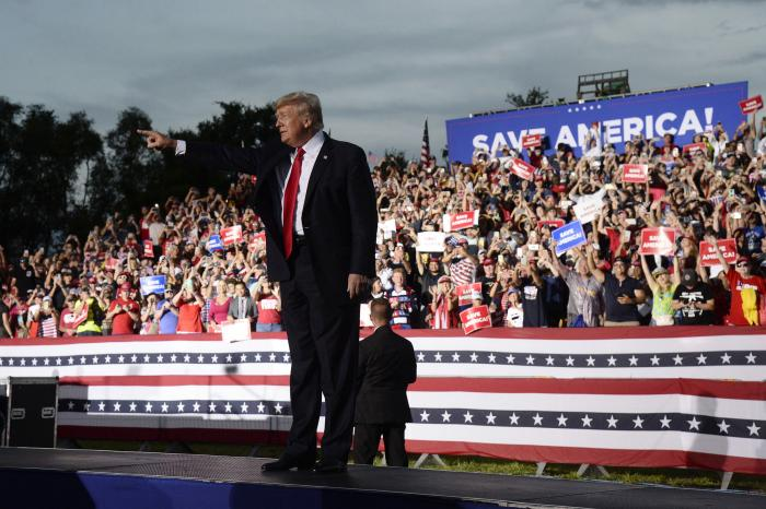 Former President Donald Trump walks on stage during a rally at the Sarasota Fairgrounds.
