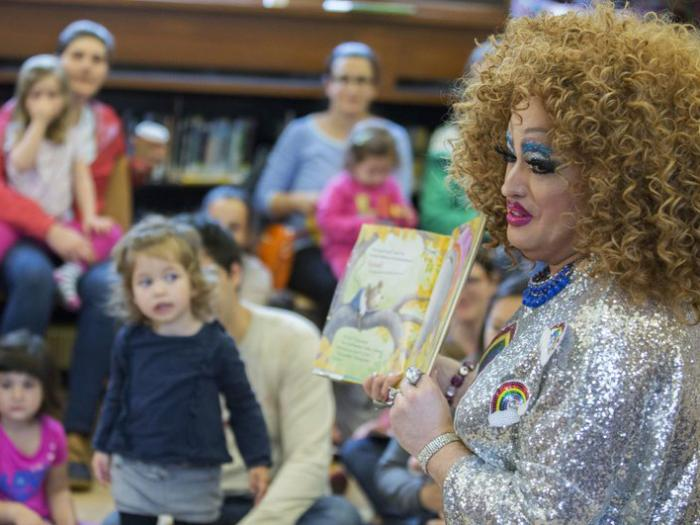 In this Saturday, May 13, 2017, photo, Lil Miss Hot Mess reads to children during the Feminist Press' presentation of Drag Queen Story Hour at the Park Slope Branch of the Brooklyn Public Library, in New York.