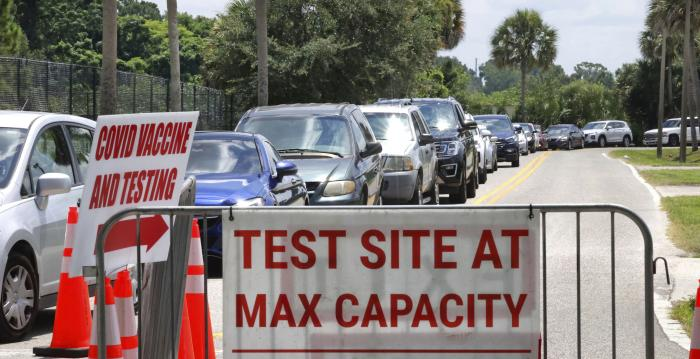 Cars line up at Miami Dade College North campus' COVID-19 testing site, Thursday, July 29, 2021, in Miami.