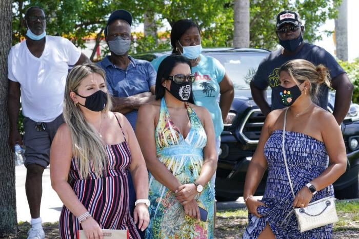 A group waits to get a COVID-19 test, Saturday, July 31, 2021, in North Miami, Fla.