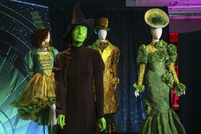 """Costumes from the Broadway musical """"Wicked"""" are displayed at the """"Showstoppers! Spectacular Costumes from Stage & Screen"""" exhibit."""