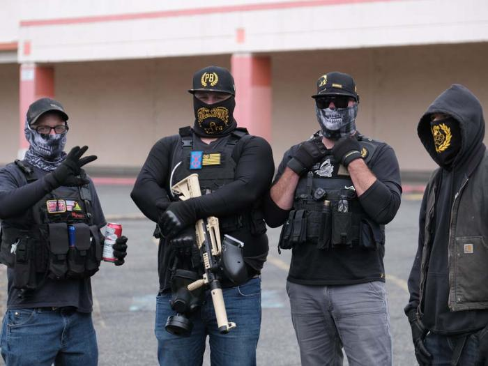 Members of the far-right group Proud Boys gather for a rally in an abandoned parking lot on the outskirts of town on Sunday, Aug. 22, 2021, in Portland, Ore.
