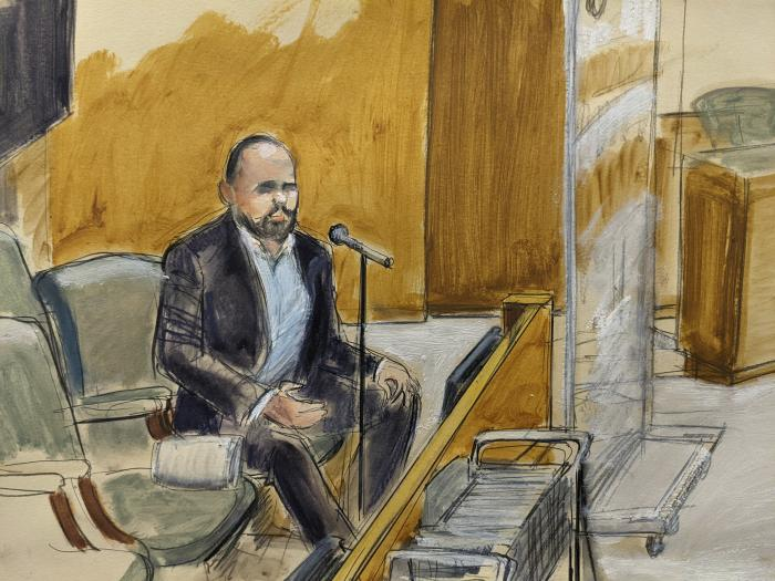 In this courtroom artist's sketch, former R. Kelly employee Tom Arnold testifies at the R&B star's trial in New York.