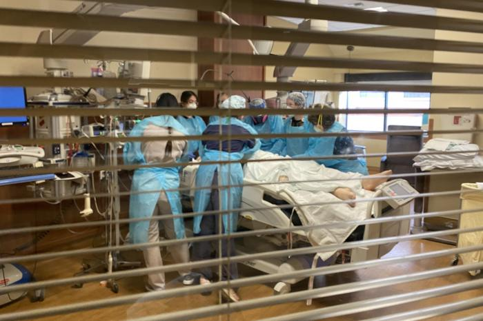 Nurses at Billings Clinic prepare to turn a patient from his stomach to his back in the hospital's intensive care unit on Sept. 17.